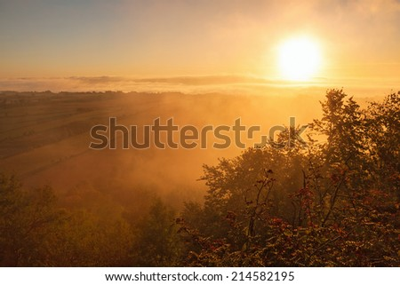 Sunricet and morning mist in the contryside landscape - stock photo