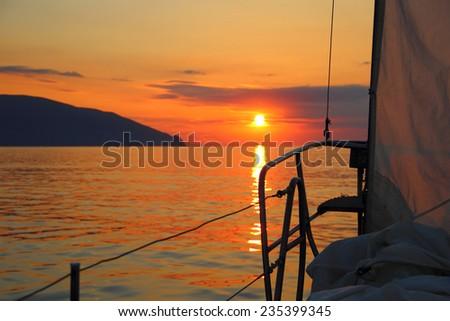 sunrise aboard a sailing yacht - stock photo