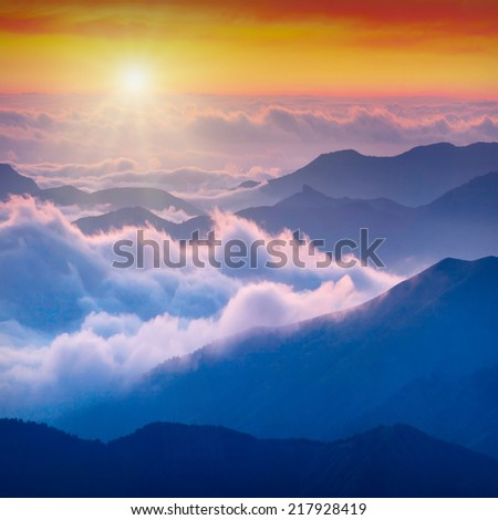 Sunrise above high mountains foggy valley of Crimea, Ukraine