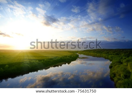 sunrise above the current river - stock photo
