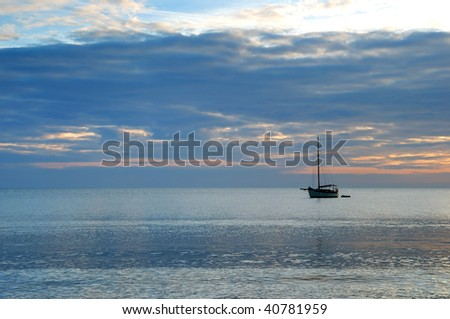 Sunrise across Swanage Bay in Dorset, England - stock photo