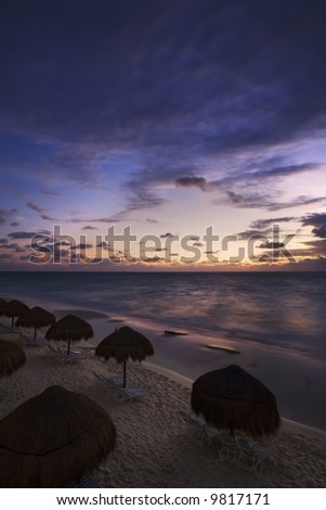 Sunrise along the white sand beaches of Cancun on the Yucatan Peninsula in Quintana Roo Mexico - stock photo