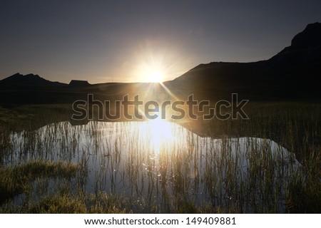 Sunrise and alpine lake (Seefeldsee/Switzerland) - stock photo