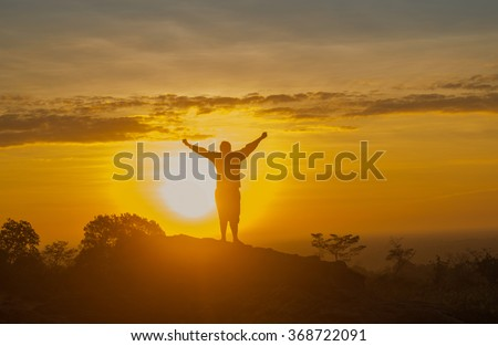 sunrise and energetic man silhouettes