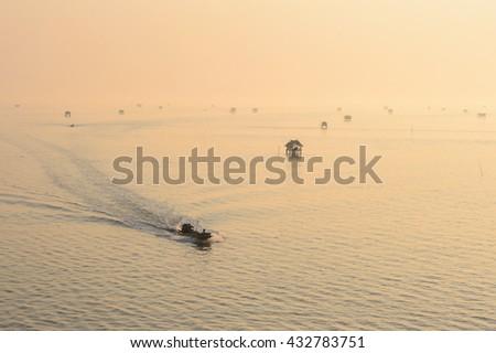 Sunrise and fisherman boat at Bang Ta Boon bay, Phetchaburi province,Thailand - stock photo