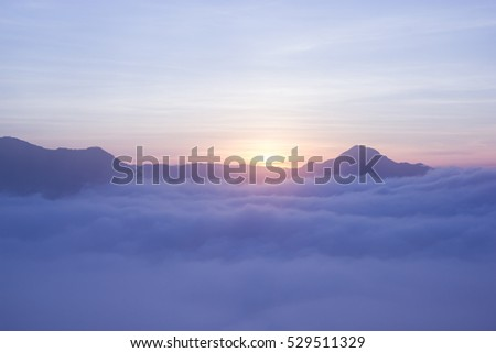 Sunrise and fog over Phu Thok Mountain at Chiang Khan ,Loei Province in Thailand
