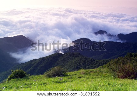 sunrise and grand cloudscape from the mountaintop