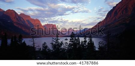 Sunrise and Wild Goose Island and Saint Mary Lake, Glacier National Park, Montana. - stock photo