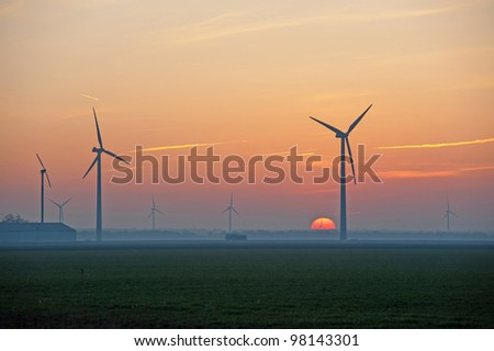 Sunrise and wind energy in winter