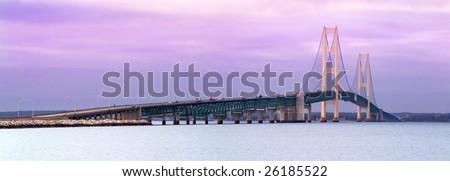 Sunrise Ar The Mackinaw Bridge, Connecting Michigan's Upper And Lower Peninsulas - stock photo