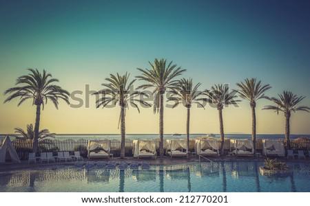Sunrise at a beach resort in tropics - stock photo