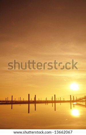 sunrise at a foggy pier - stock photo