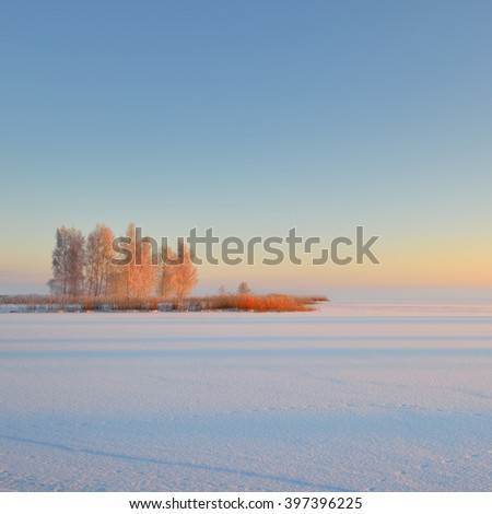 Sunrise at a frozen lake in Riga, Latvia during hoar frost - stock photo
