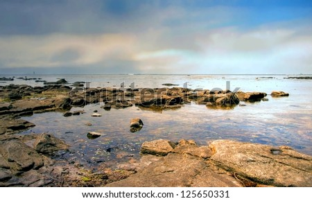 sunrise at a rocky beach in the south of France, Europe - stock photo