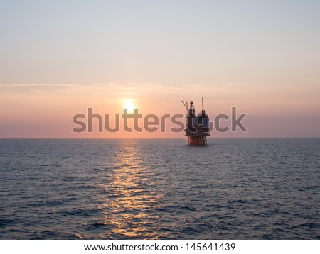 Sunrise at an offshore oil platform on the North Sea, in the Norwegian sector - stock photo