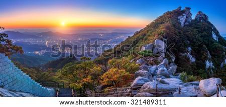 Sunrise at Baegundae peak and Bukhansan mountains in autumn,Seoul in South Korea. - stock photo