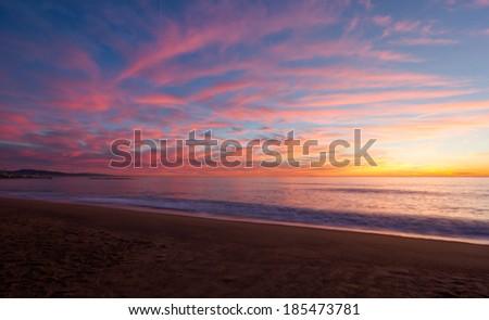 Sunrise at Barceloneta Beach - Barcelona, Spain - stock photo