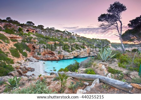 sunrise at beautiful beach bay azure sea water, Cala des Moro, Majorca island, Spain                                 - stock photo
