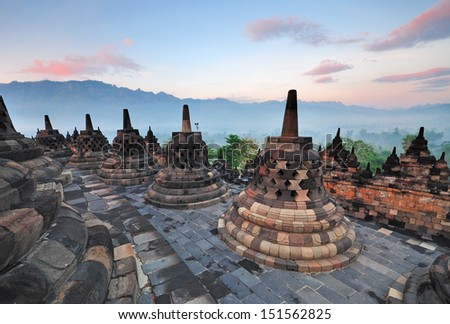 Sunrise at Borobudur Temple Stupas, Yogjakarta East Java Indonesia.  - stock photo