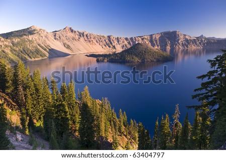 Sunrise at Crater Lake Volcano in Oregon - stock photo