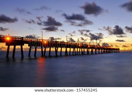 Sunrise at Dania Pier in Ft Lauderdale / Orange Stars - stock photo
