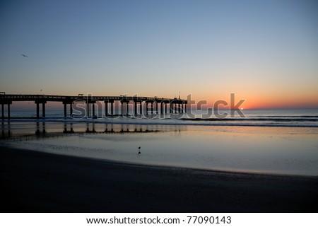 sunrise at fishing pier st. augustine beach florida usa - stock photo