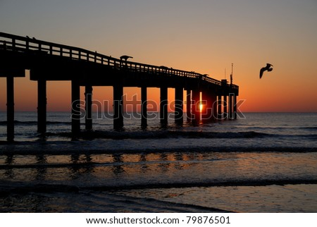 Sunrise at fishing pier St. Augustine Beach, Florida, Usa - stock photo
