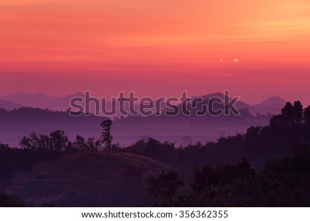 Sunrise at landscape with fog in the mountain  - stock photo