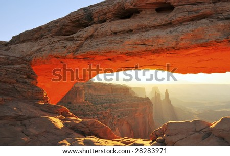 Sunrise at Mesa Arch in Canyonlands National Park near Moab, Utah. - stock photo