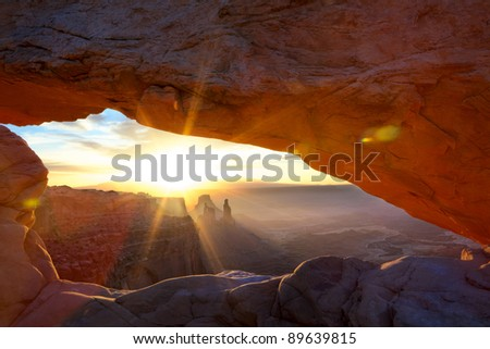 Sunrise at Mesa Arch in Canyonlands National Park near Moab, Utah, USA - stock photo