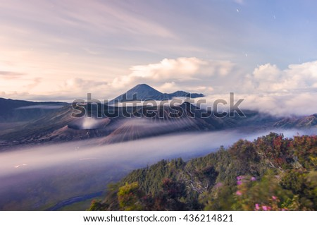 Sunrise at Mount Bromo volcano, the magnificent view of Mt. Bromo located in Bromo Tengger Semeru National Park, East Java, Indonesia. Soft Focus due to Long Exposure Shot. Copy Space Area. - stock photo