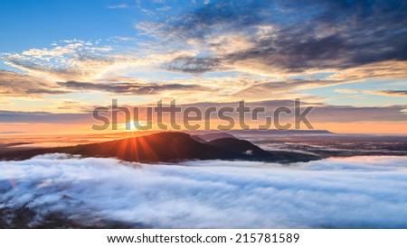 Sunrise at Pha Mo I Daeng Cliff and mist, Sisaket, Thailand - stock photo