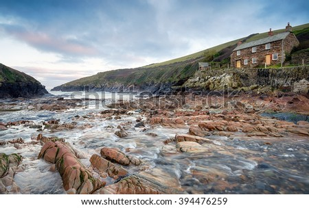 Sunrise at Port Quin on the north coast of Cornwall - stock photo