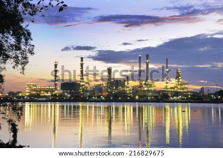 Sunrise at refinery - stock photo
