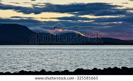 Sunrise at Reykjavik harbor with dramatic cloudscape over the coast, Iceland - stock photo