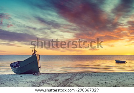 Sunrise at sandy beach of the Baltic Sea, Europe. Image slightly toned in vintage warm colors style - stock photo