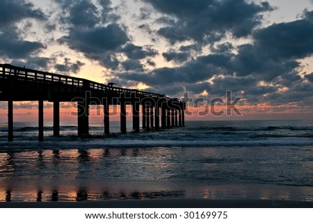 Sunrise at St. Augustine fishing pier in Florida. - stock photo