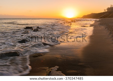 sunrise at the Baltic Coast of Usedom Island in Germany - stock photo