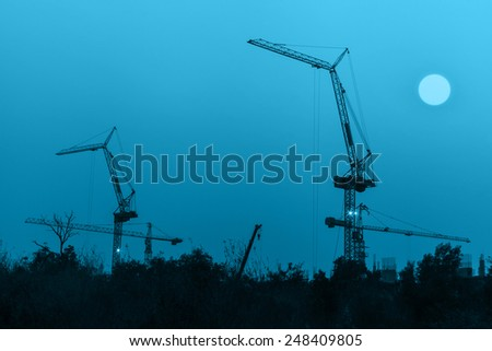 Sunrise at the construction site - stock photo