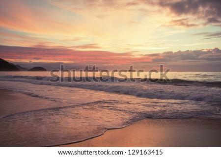 Sunrise at the famous Copacabana beach in Rio de Janeiro, Brazil - stock photo