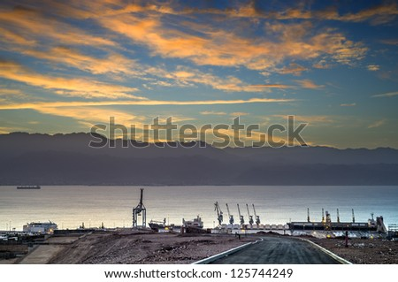 Sunrise at the Gulf of Aqaba, view on marine port of Eilat from surrounding hills - stock photo