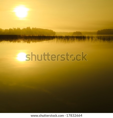 Sunrise at the lake in eastern part of Finland (golden version) - stock photo