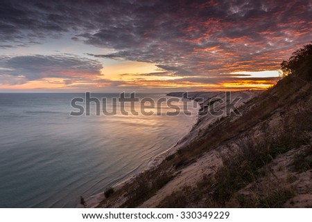 Sunrise at the Log Slide Overlook at Pictured Rocks National Lakeshore. Located in Michigan between Munising and Grand Marais.  - stock photo