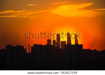 Sunrise at the Moscow city. Silhouette of buildings. - stock photo