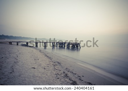 Sunrise at the pier in Sopot, Poland. Vintage landscape - stock photo