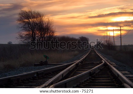 Sunrise at the railroad crossing - stock photo