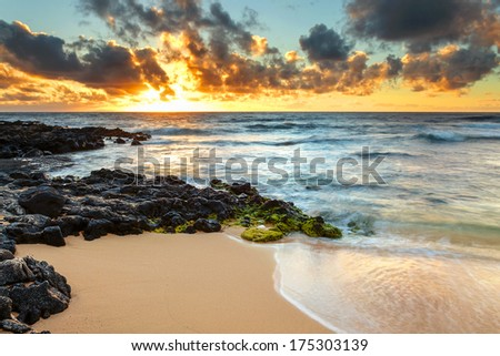 Sunrise at the shore of Sandy Beach on Oahu, Hawaii - stock photo