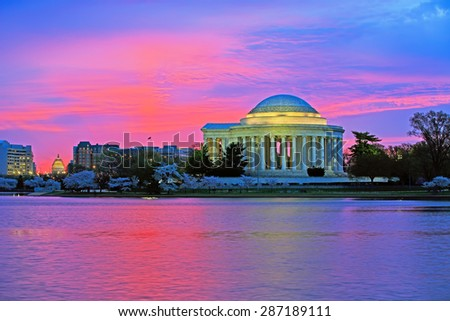 Sunrise at the Thomas Jefferson Memorial in Washington DC. The famous cherry trees are in full bloom. - stock photo