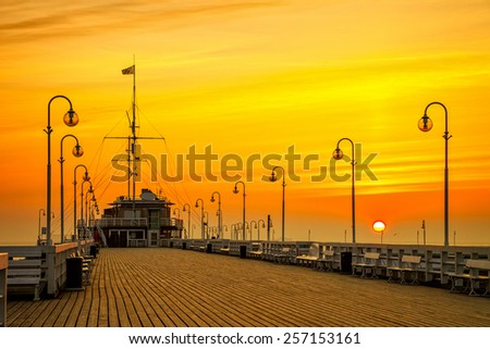 Sunrise at the wooden pier in Sopot, Poland. - stock photo