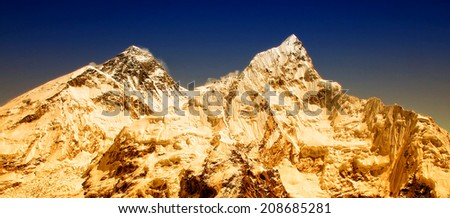 Sunrise at the world's highest mountain, Mt Everest (8850m) and Mt. Nuptse in the Himalayas, Nepal. - stock photo
